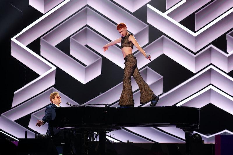 "Olly Alexander & Elton John performing ""It's A Sin"" at the 2021 BRIT Awards."