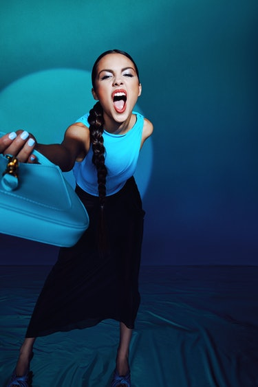 """Drivers License"" singer Olivia Rodrigo wears a blue top and long black skirt for NYLON's cover."