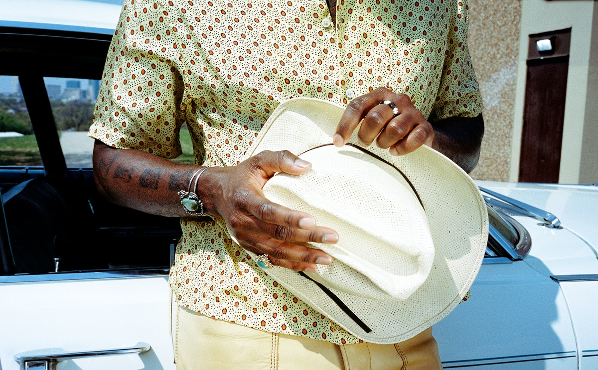 Leon Bridges wears a Bode shirt; his own hat and jewelry.