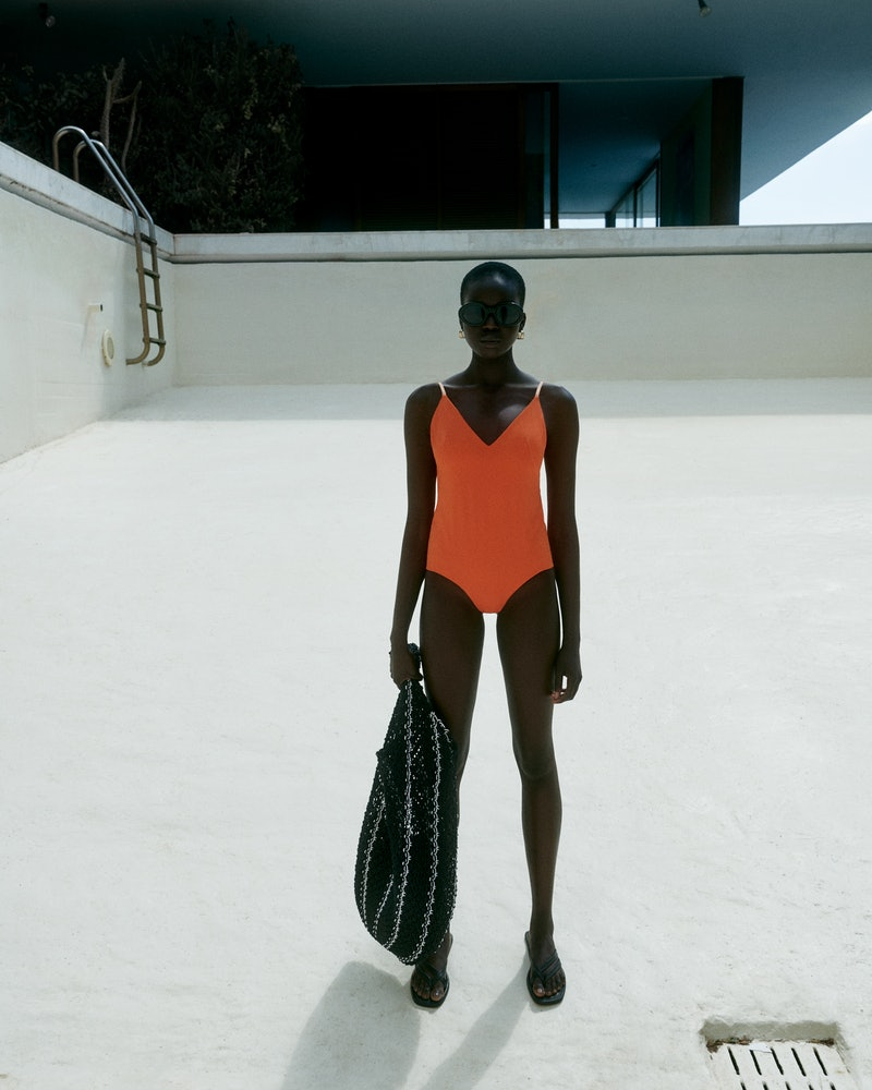 Contemporary high-street brand COS launches its new Summer swimwear collection, which is full of neutral beachwear with pops of orange and blue throughout the collection.