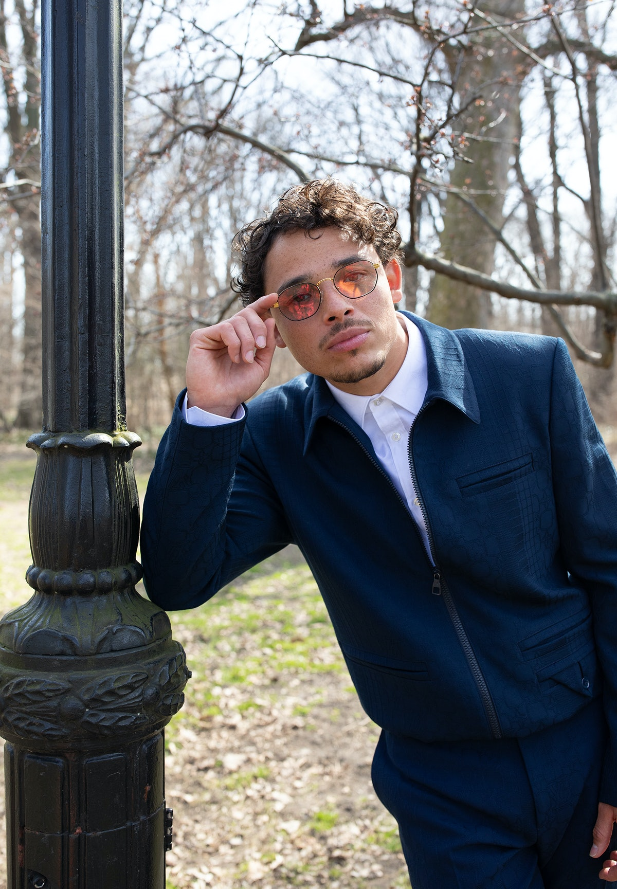 Anthony Ramos wears a Louis Vuitton Men's jacket, shirt, and pants; stylist's own sunglasses. Grooming by Lisa Torres.