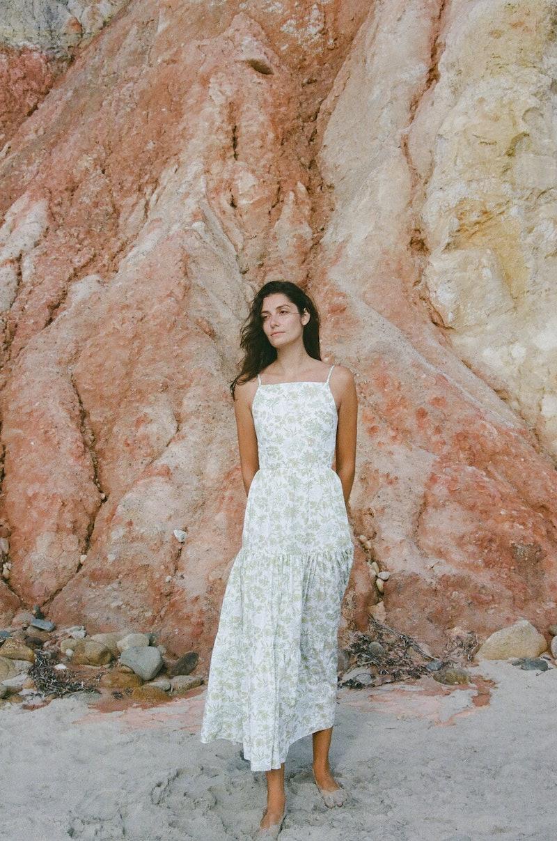 Model wears wedding guest dress from Coco Shop.