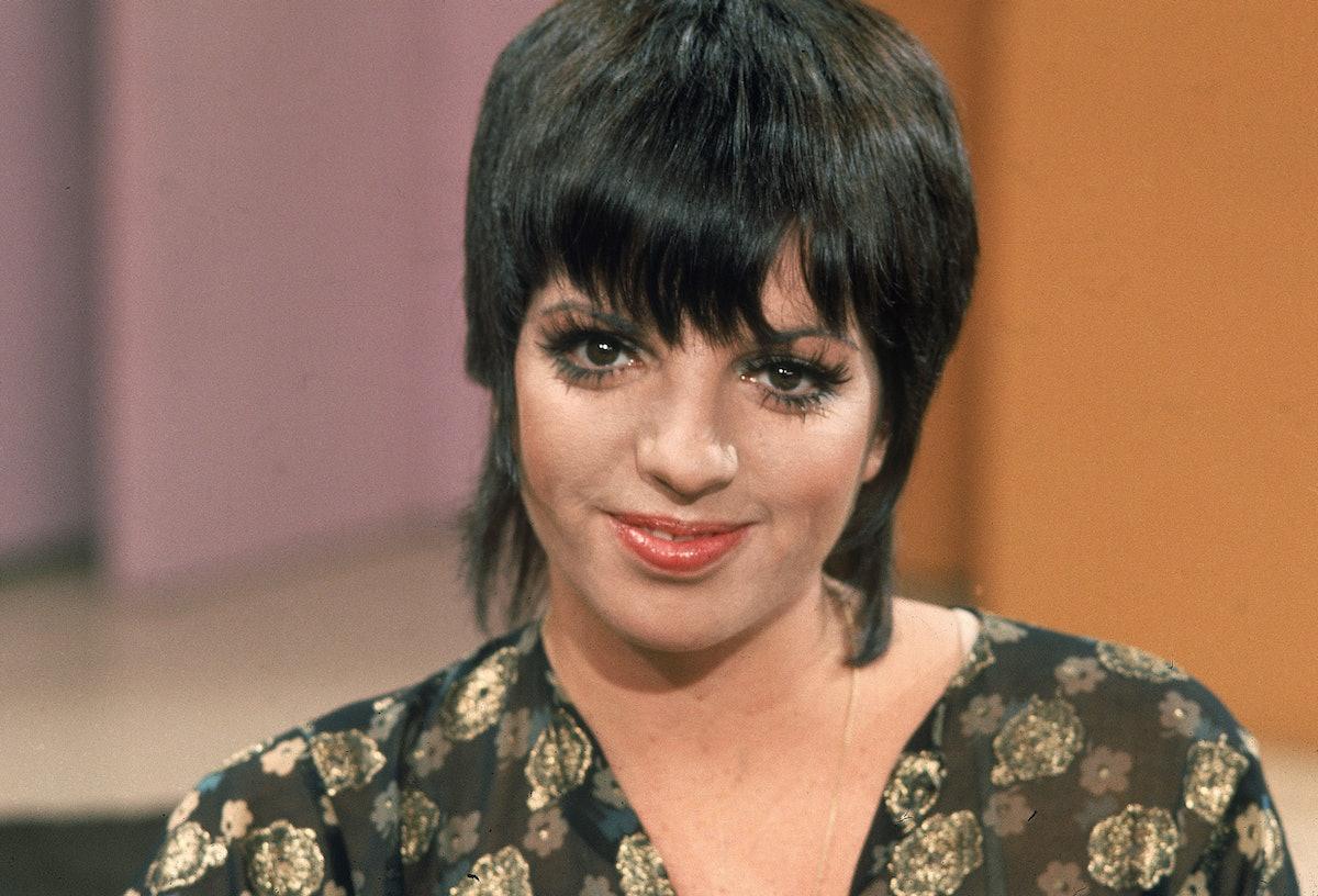 Liza with a black shag haircut