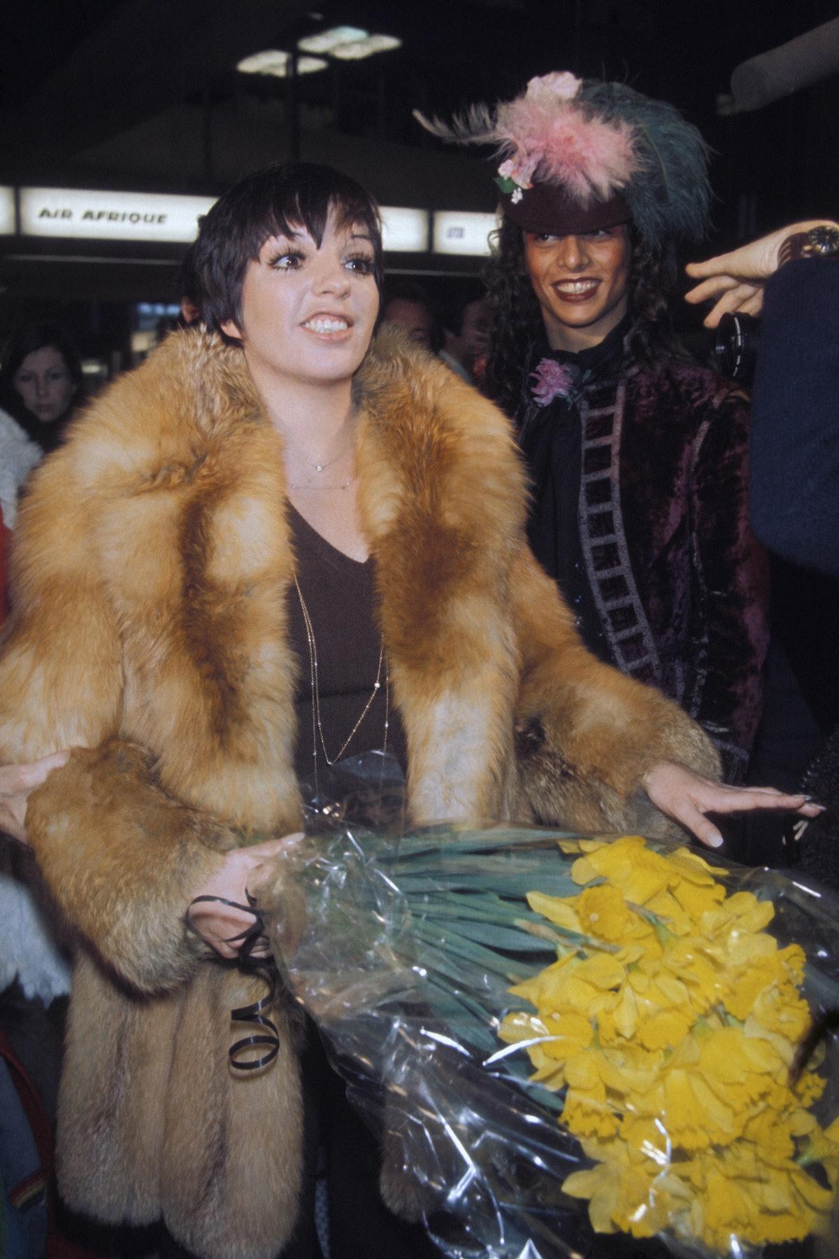 Liza wearing fur coat