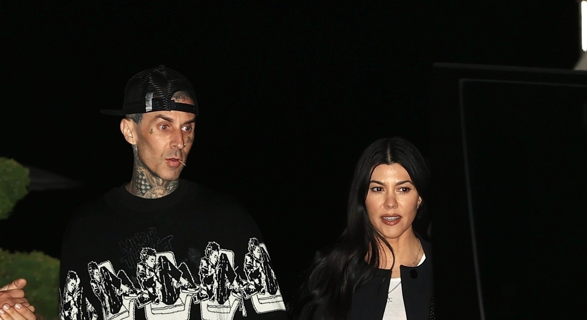 From vintage-inspired tops to open flannel shirts, see Kourtney Kardashian & Travis Barker's best '90s looks as a couple, ahead.