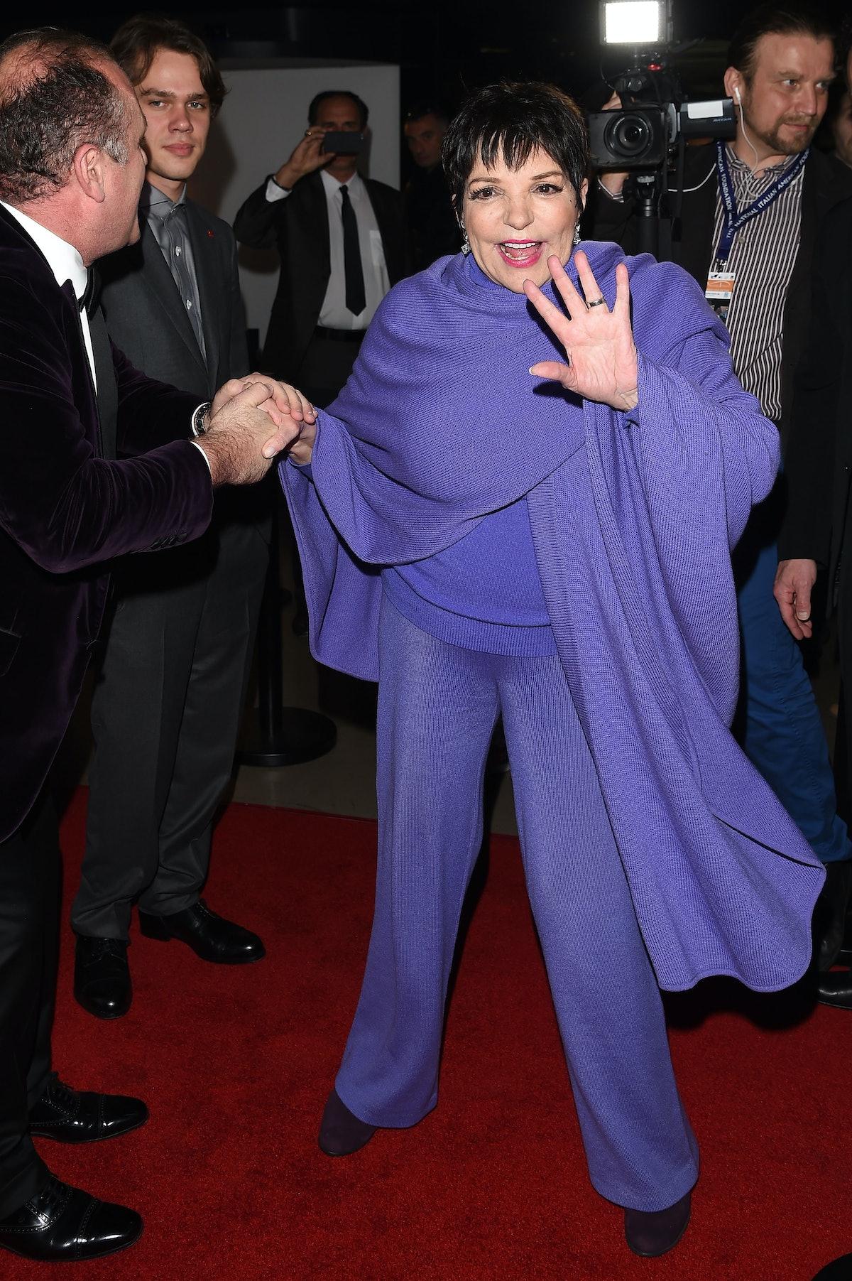 Liza wears a purple set