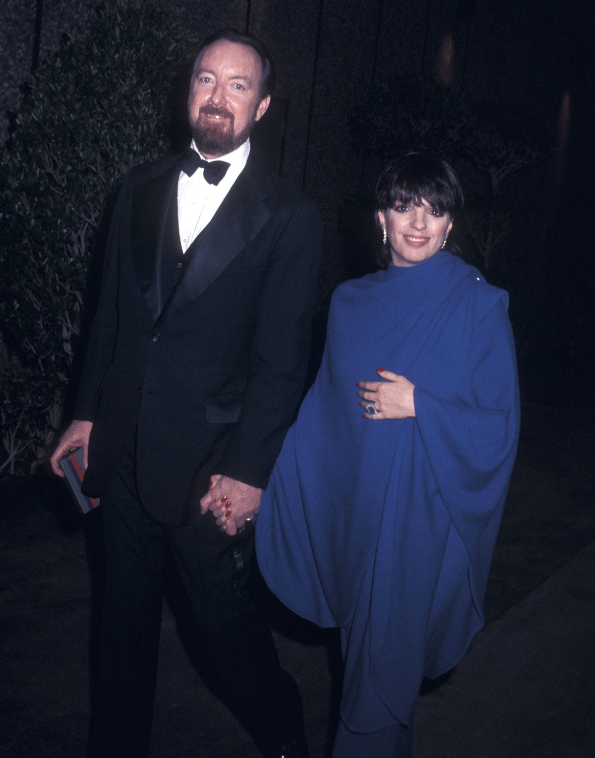 Jack Haley Jr in a black tux, Liza in a blue ensemble