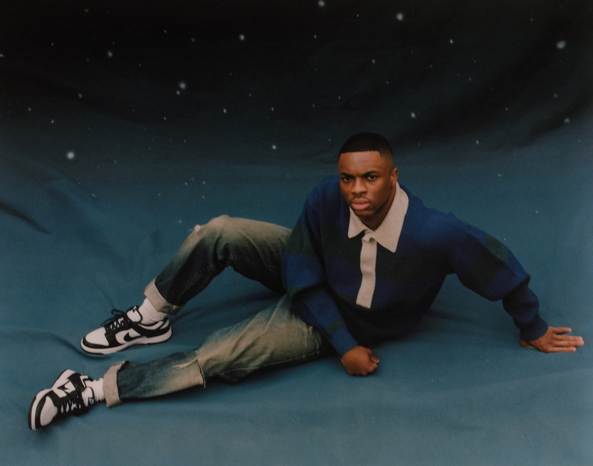 Vince Staples wears an Isabel Marant sweater; Nike sneakers; stylist's own jeans and socks.
