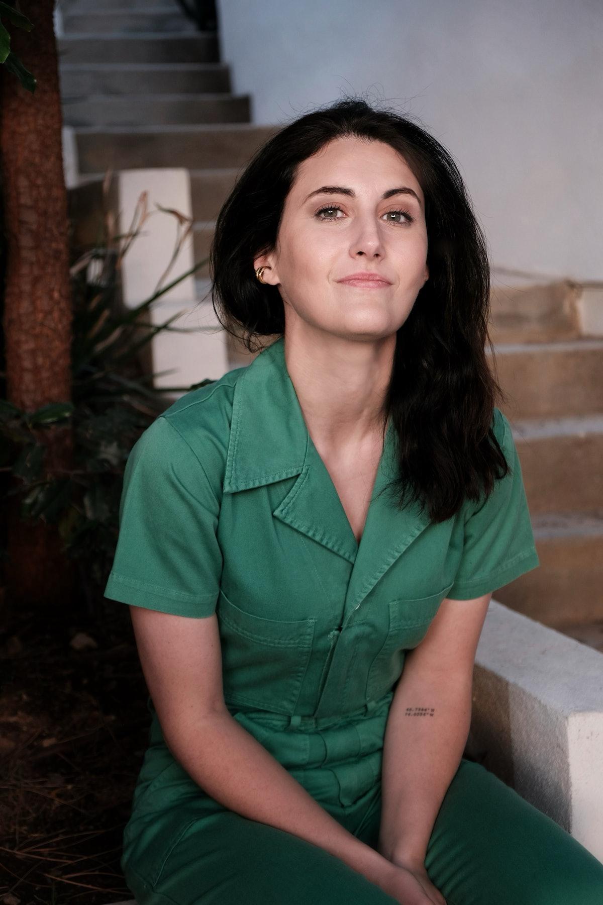 Jen Statsky wearing green jumpsuit