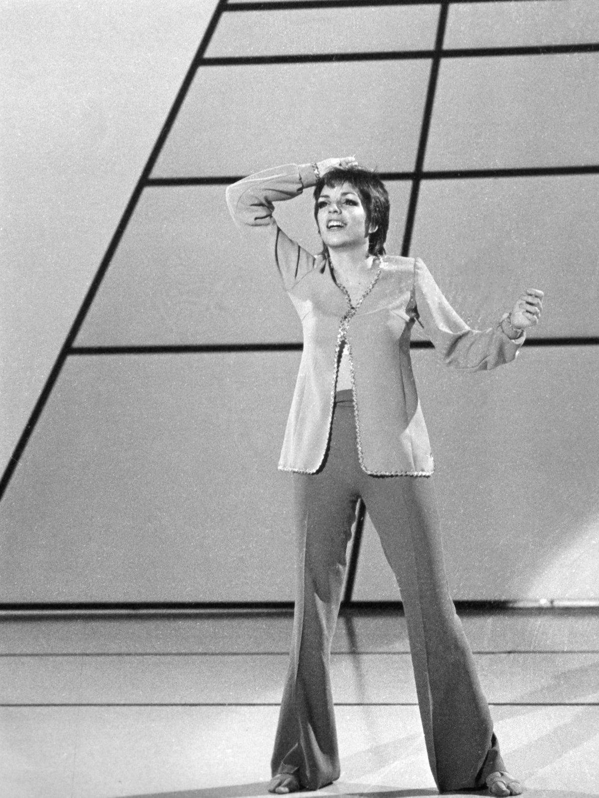 Liza wearing bell bottoms on stage