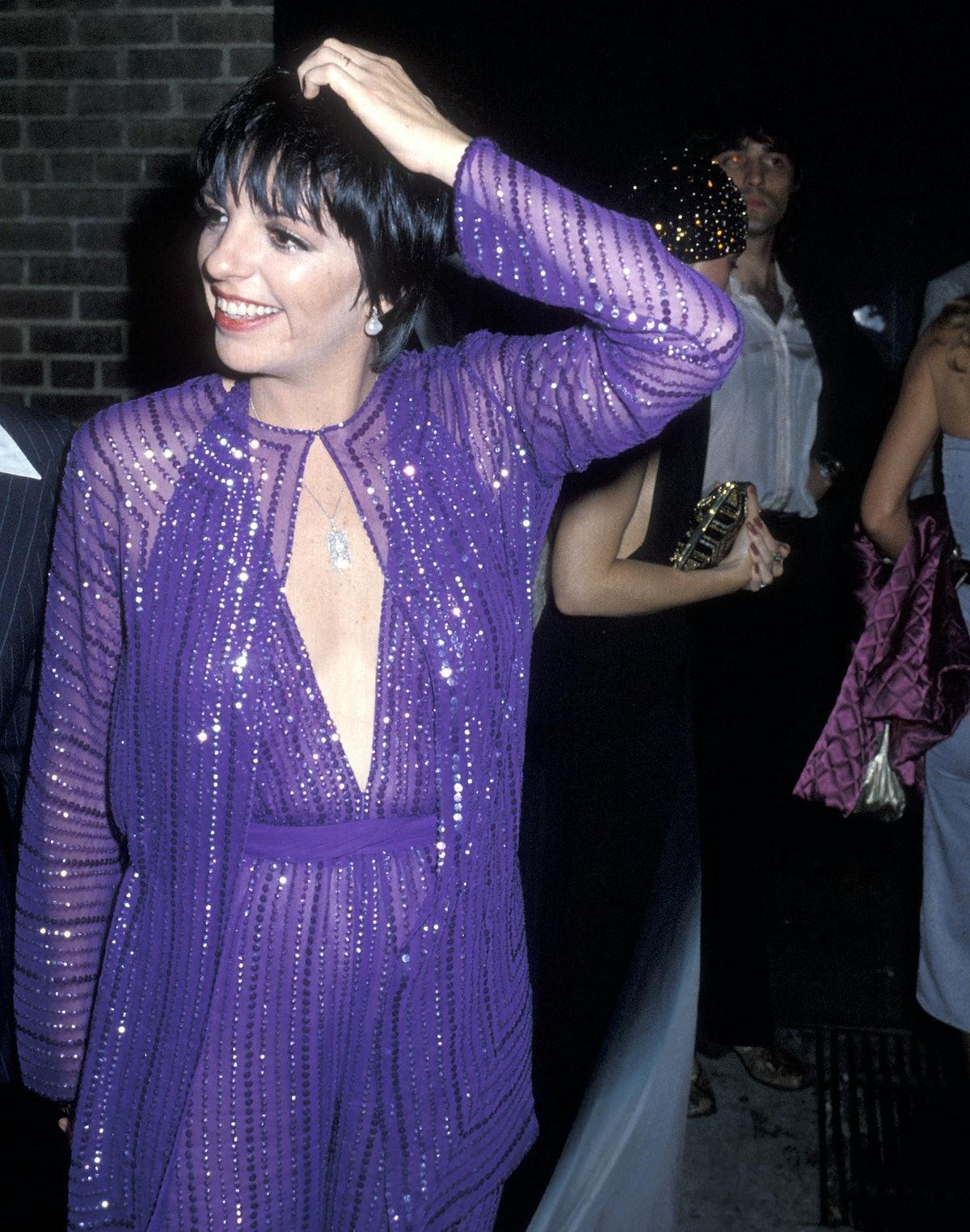 Liza wearing purple jumpsuit