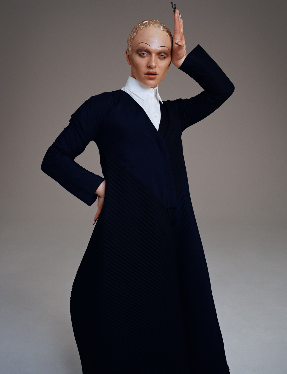 Model Bimini Bon Boulash wears a Loewe jacket and skirt; Prada white romper.