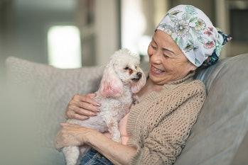 Woman with cancer relaxes with dog