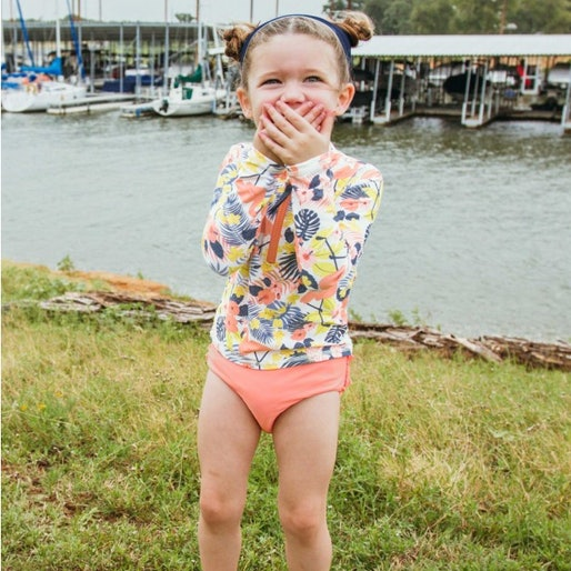 toddler girl in a bathing suit