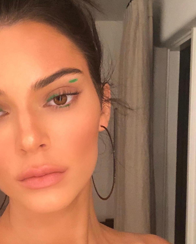 Kendall Jenner wearing green graphic eyeliner.