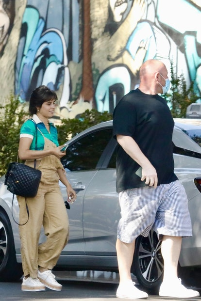 Camila Cabello sports beige overalls while out running some errands in Beverly Hills.