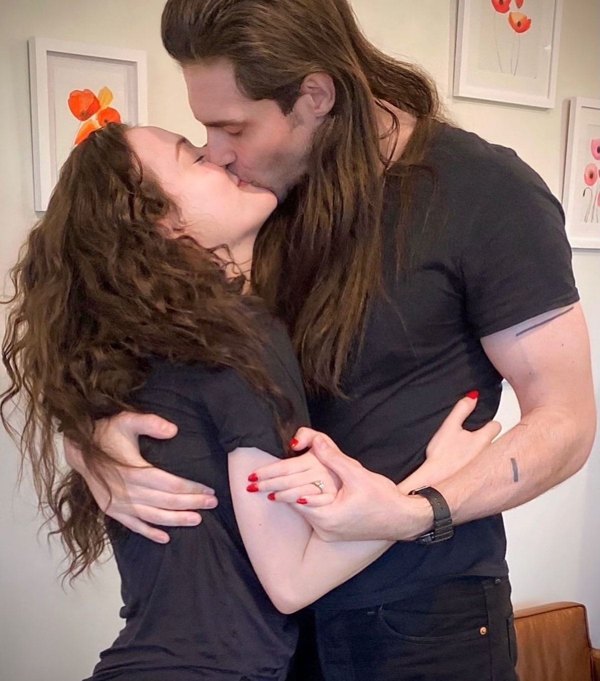 Kat Dennings and Andrew WK kissing.