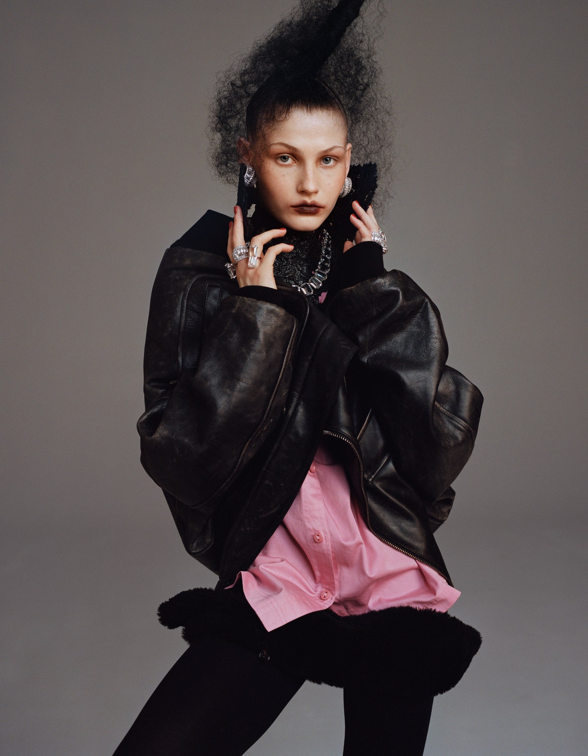 Model Tayla Jade wears a Burberry jacket and shirt; Swarovski earrings, necklace,  and rings; Elissa...