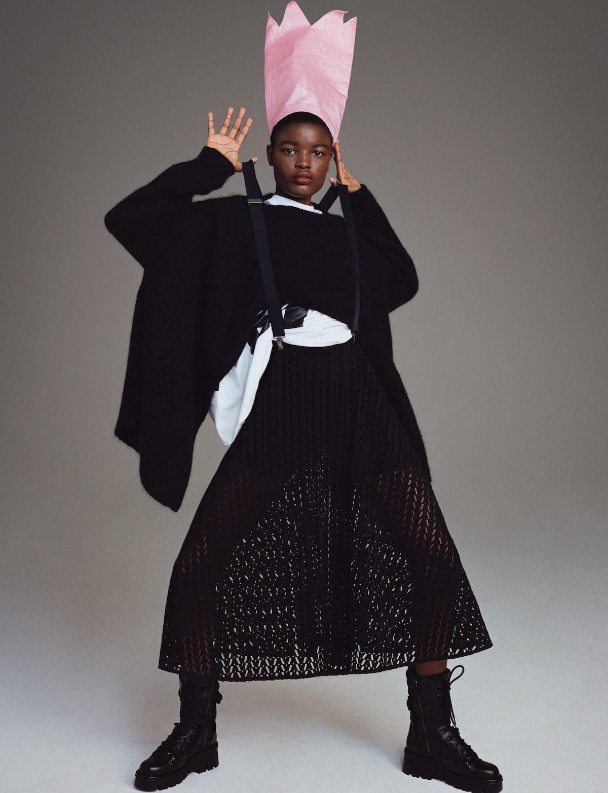 Model Anya Ekung wears a Valentino sweater and skirt; MSGM x the Perfect Magazine T-shirt; Ru Yenn h...