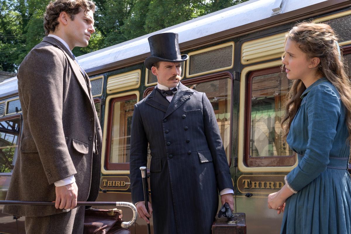 Millie Bobby Brown as Enola Holmes, Henry Cavill as Sherlock Holmes, and Sam Claflin as Mycroft Holmes in Enola Holmes