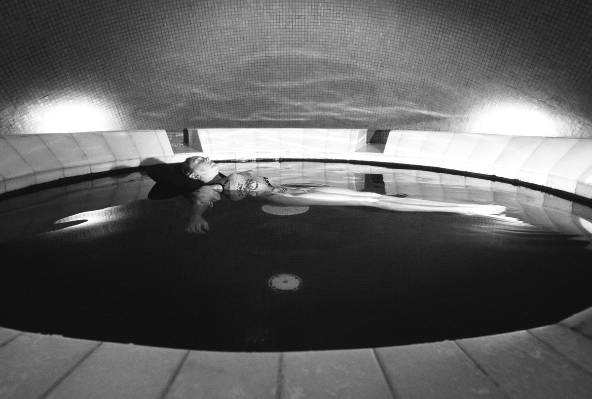 woman floating in a sensory deprivation pool