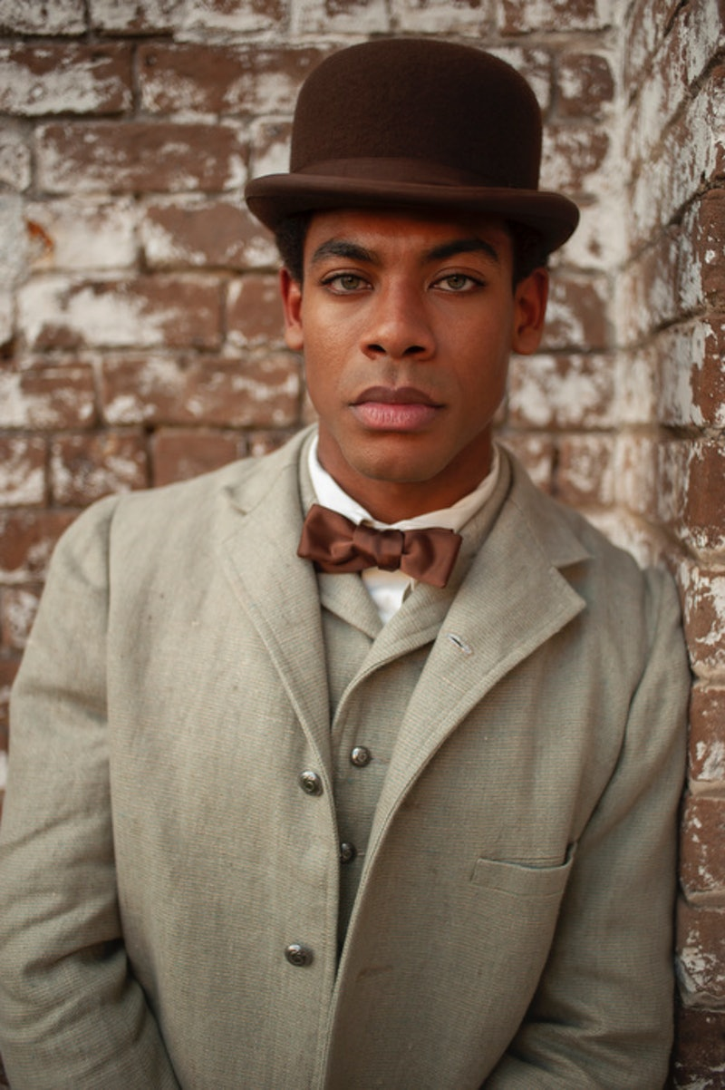 A vertical photo of actor Aaron Pierre, in character as Caesar on 'The Underground Railroad'