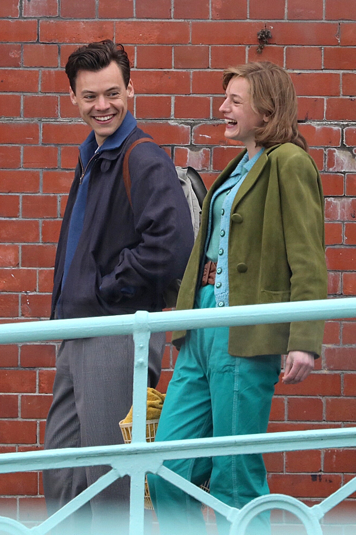 Harry Styles and Emma Corrin laughing on the set of My Policeman