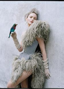 Jennifer Lawrence holding a bird