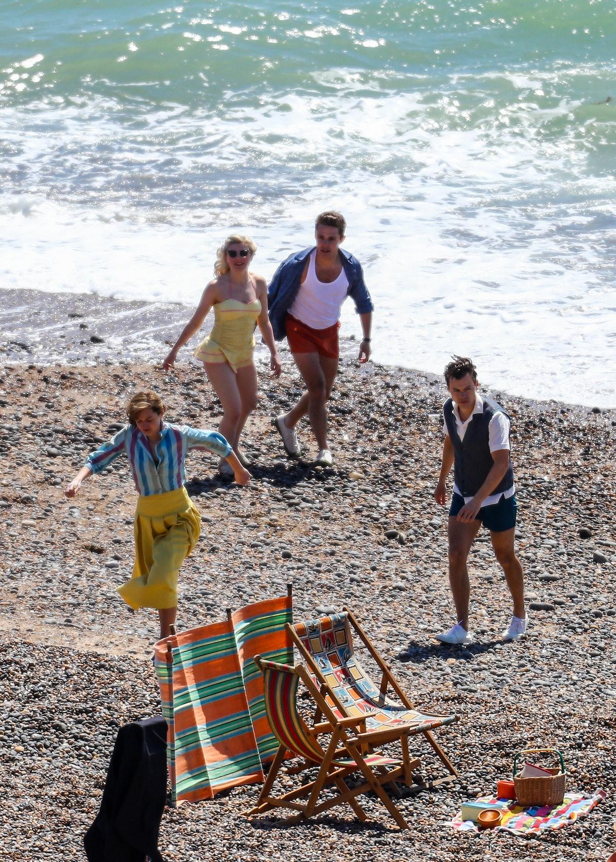 Harry Styles and Emma Corrin on the beach