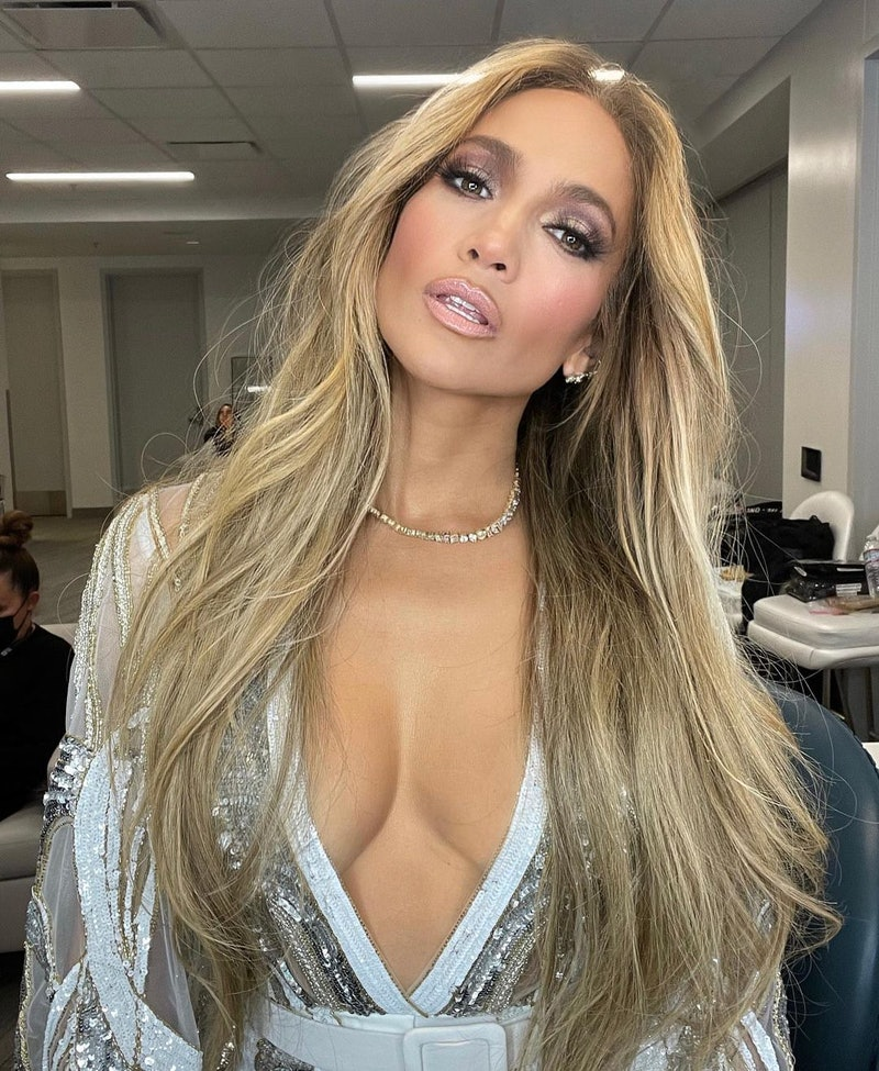glam photo of jennifer lopez with long flowing blonde hair and smoky makeup