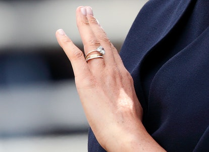 Meghan, Duchess of Sussex (ring detail) travels down The Mall in a horse drawn carriage during Trooping The Colour