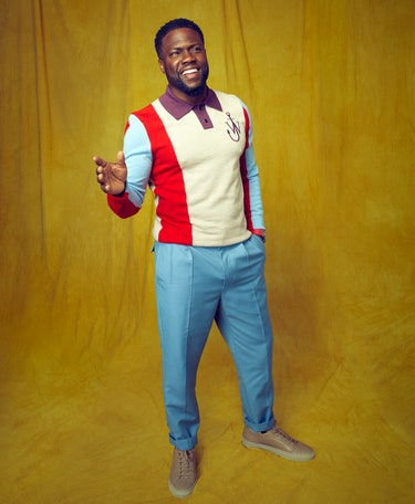 Kevin Hart wears a red, blue, and yellow JW Anderson sweater while posing for Romper's Father's Day ...