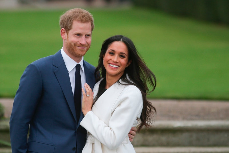 Britain's Prince Harry and his fiancée US actress Meghan Markle pose for a photograph in the Sunken Garden at Kensington Palace in west London on November 27, 2017