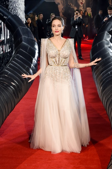 Angelina Jolie in a silver dress with a cape