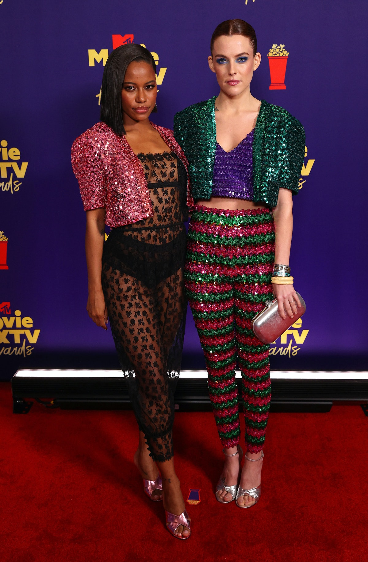 Taylour Paige and Riley Keough in Gucci
