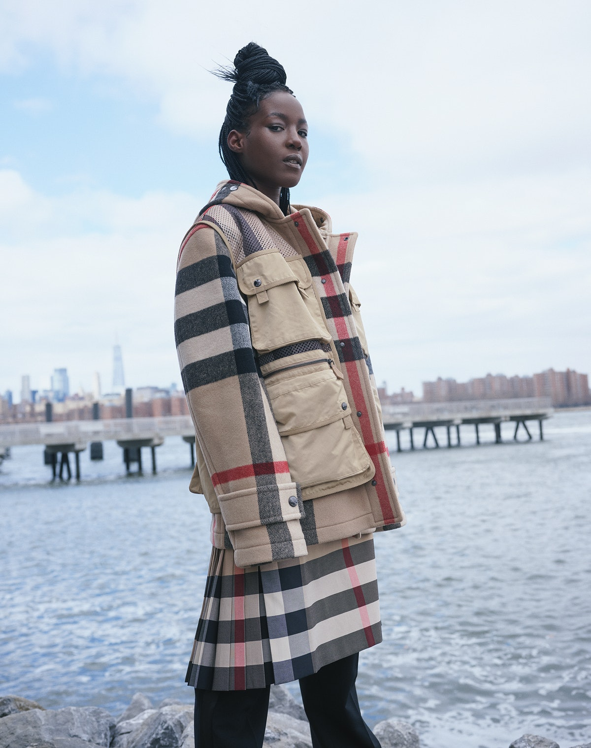 Hawa wears a Burberry coat with detachable vest, skirt, and pants.