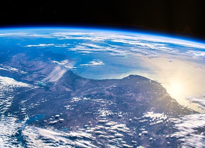 Sunlight reflects off the Earth's surface