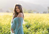 woman wearing beautiful maternity gown for photoshoot