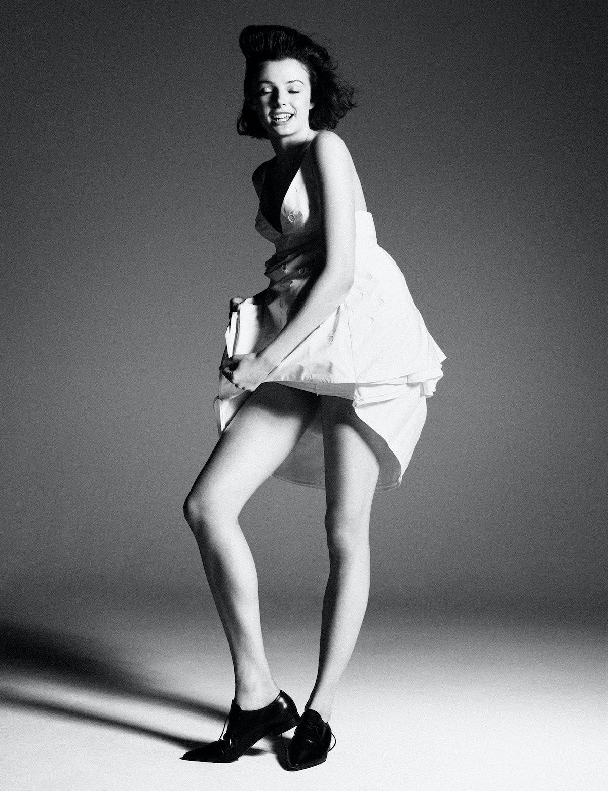 Model Grace Clover wears a Prada dress; Maison Margiela shoes.