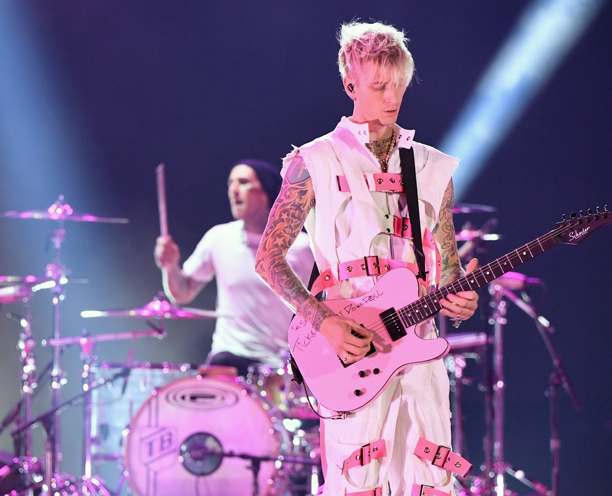 Travis Barker and Machine Gun Kelly perform onstage for the 2020 American Music Awards at Microsoft Theater on November 22, 2020 in Los Angeles, California. Photo by Kevin Mazur/AMA2020/Getty Images.