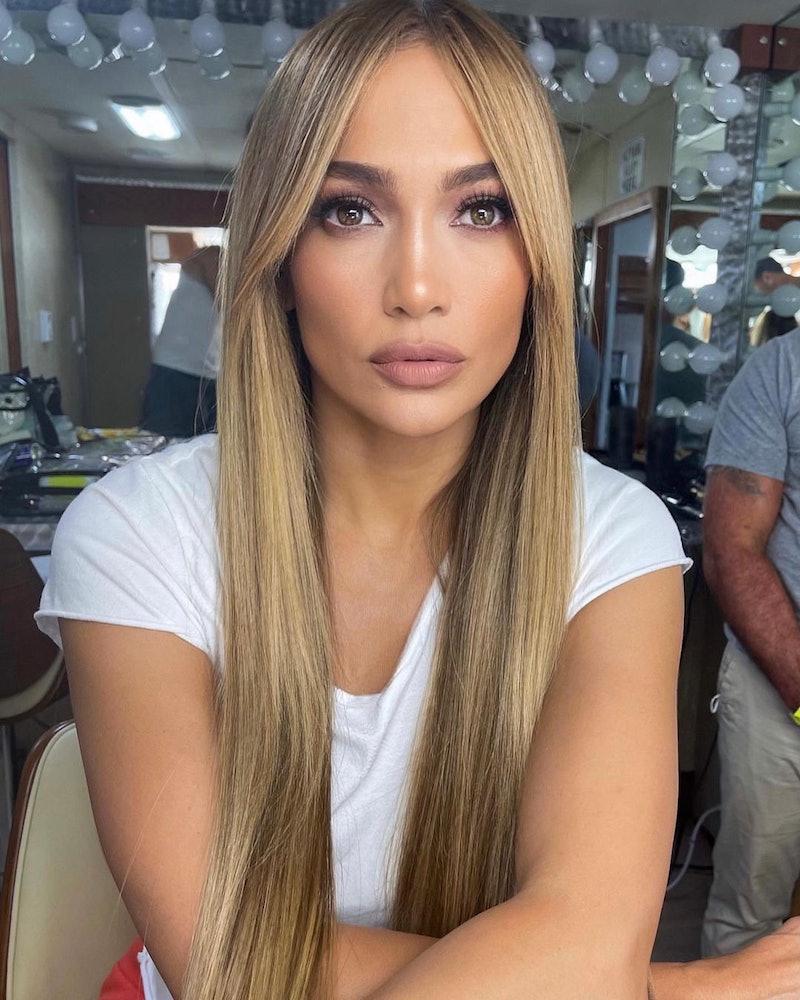 Jennifer Lopez has a new set of super chic blunt curtain bangs, courtesy of celeb hairstylist Chris Appleton.