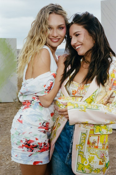 Former 'Dance Moms' stars Maddie & Kenzie Ziegler pose together outside for Elite Daily's cover.