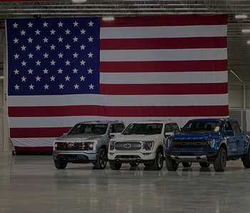 Ford's all-electric F-150 pickup truck is seen at a Biden press event.