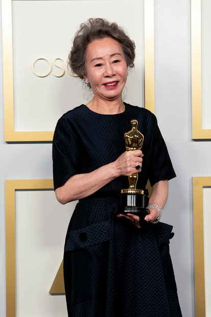 """`LOS ANGELES, CALIFORNIA – APRIL 25: (EDITORIAL USE ONLY) In this handout photo provided by A.M.P.A.S., Yuh-Jung Youn, winner of Best Actress in a Supporting Role for """"Minari,"""" poses in the press room during the 93rd Annual Academy Awards at Union Station on April 25, 2021 in Los Angeles, California."""