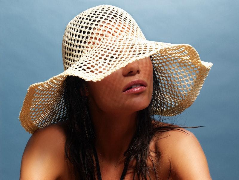 Tan woman in sun hat