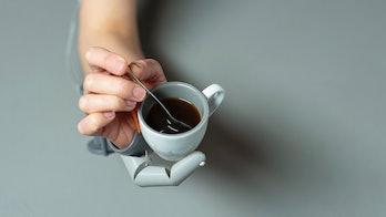 robot thumb holding tea cup
