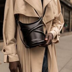 Blogger/digital creator Amy Julliette Lefévre wears a new Curve crossbody bag by Alexander McQueen.