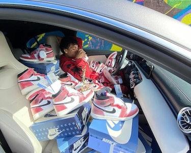 "Sneaker reseller posing with Nike's Air Jordan 1 x Trophy Room ""Freeze Out"" sneaker"