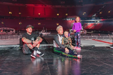 Pink with her family sitting on stage in empty theater