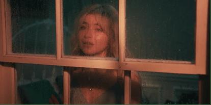 """Sabrina Carpenter in her """"Skin"""" music video."""